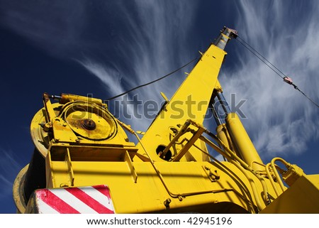 crane arm against a blue sky - stock photo