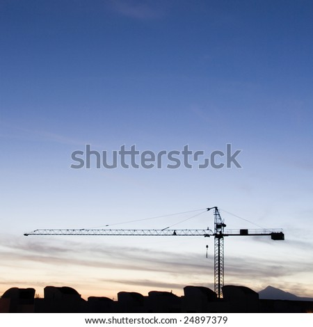 crane at a blue sunset - stock photo