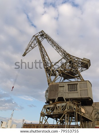 Crane at harbor - stock photo