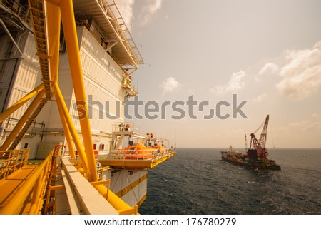 crane barge doing marine heavy lift installation works in the gulf or the sea - stock photo