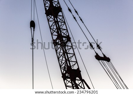 Crane Cables Rigging Abstract Construction crane cables pulleys rigging hoisting structure abstract silhouetted - stock photo