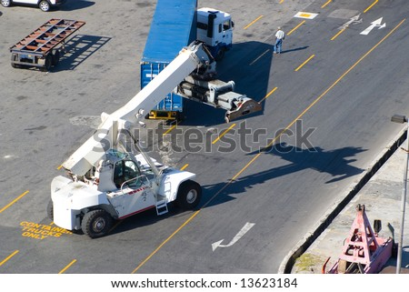crane car loading for truck in pier - stock photo