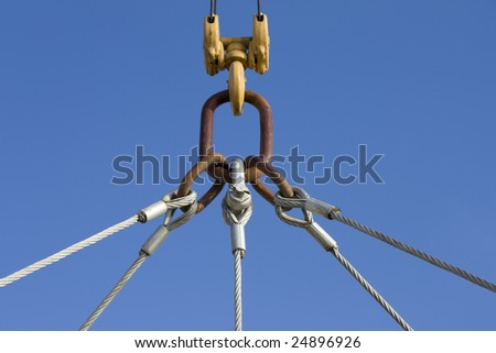 Crane detail with blue sky in background - stock photo