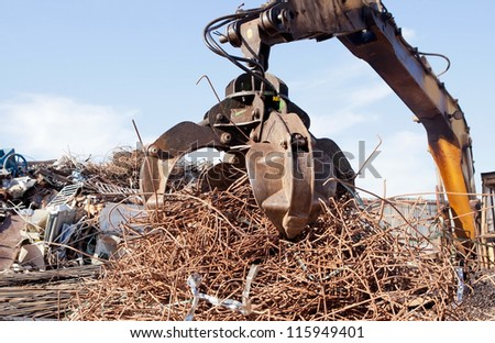 crane grabber loading metal scrap - stock photo