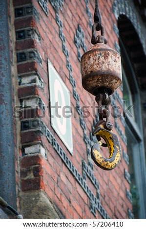 Crane hook in front of old red bricked warehouse in traditional Hamburg Speicherstadt (harbour district)