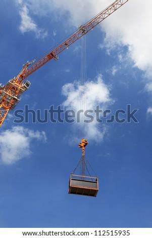 Crane Hook on a blue sky - stock photo