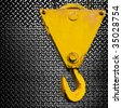 crane hook on diamond plate - stock photo
