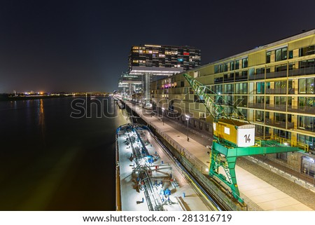 crane houses on the Rhine-shore at night in cologne - stock photo