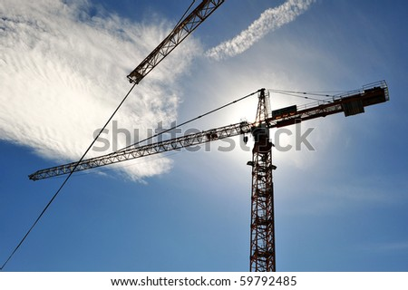 Crane in beams of the sun - stock photo
