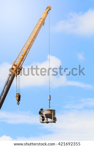 Crane in building construction site - stock photo
