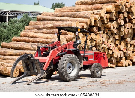 Crane in the logging facility. - stock photo