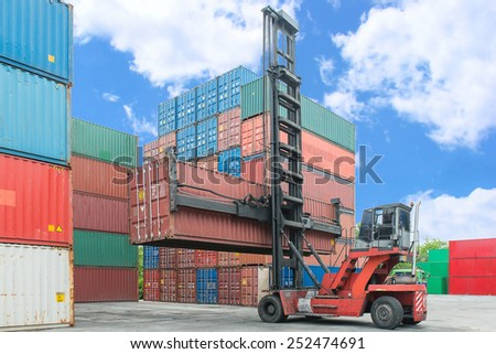Crane lifter handling container box loading to depot - stock photo