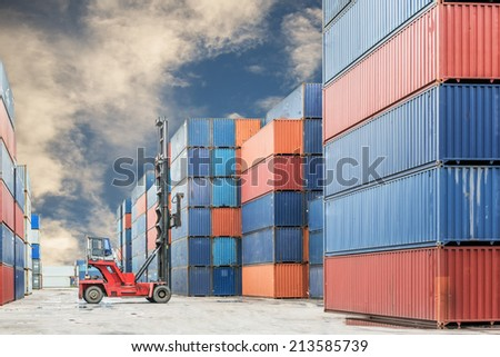 Crane lifter handling container box loading to truck in import export  - stock photo