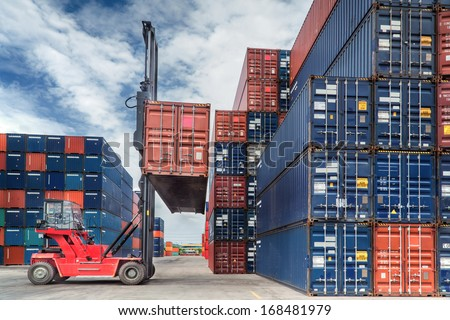 Crane lifter handling container box loading to truck in import export logustic zone - stock photo