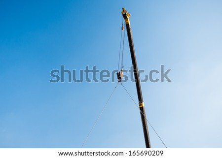 Crane lifting cement block