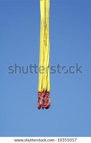 Crane lifting ropes. Released hooks - stock photo