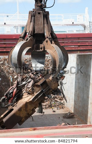 Crane Loading cargo Ship With Recycling Steel, Galway docks - stock photo