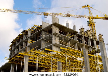 crane near building on Cloudy sky background - stock photo