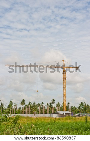 crane near building on Cloudy sky background