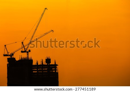 Crane on a construction site. - stock photo