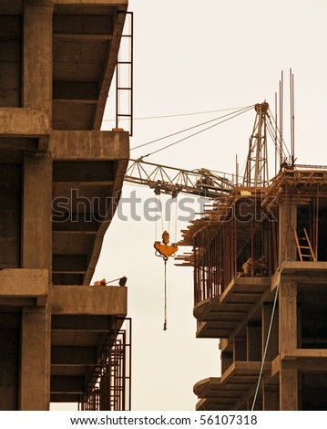 Crane on the background building. Construction of new homes. Concrete slabs. Building. Industry - stock photo
