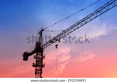 Crane on the construction site in the sunset 