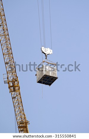 crane with a load - stock photo