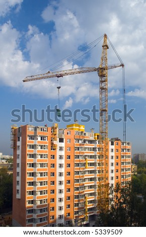 crane with buildings in the background - stock photo