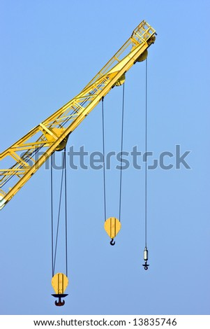 Crane with three different hooks