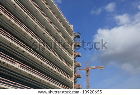 Crane working at a construction site with space for text - stock photo