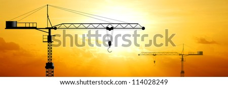 Crane working construction for business industrial and sunset background for design - stock photo