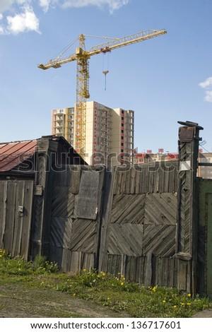 Crane working heavy construction. - stock photo