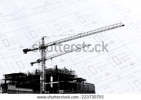 Crane working in construction site  - stock photo