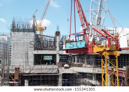 Crane working on building under construction. - stock photo