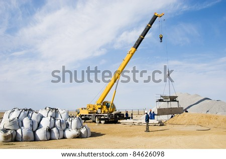 crane works on construction site - stock photo