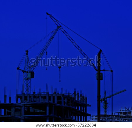Cranes against a background of construction