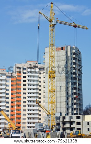 Cranes and building construction - stock photo