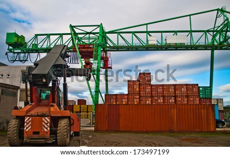 Cranes and cargo container on a storage site - stock photo