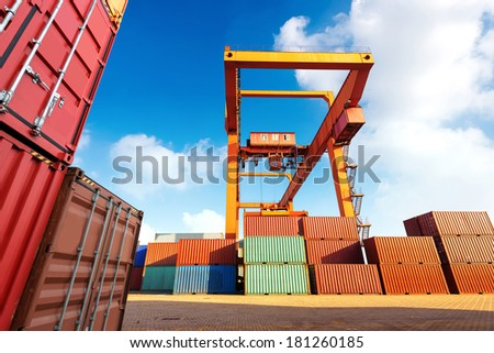 Cranes and container pier under the blue sky - stock photo