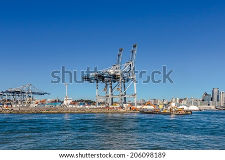 Cranes and containers in the port of Auckland - stock photo