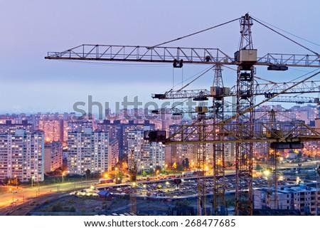 Cranes and housing estate. Kiev, Ukraine. Kyiv, Ukraine - stock photo