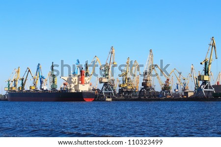 Cranes and ship on the loading port
