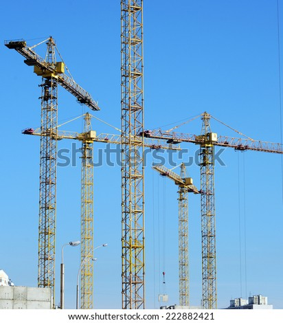 Cranes at a construction site . - stock photo