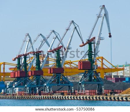 cranes at coal terminal at russian port Vladivostok - stock photo
