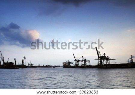 cranes at dock at evening, Hamburg - stock photo