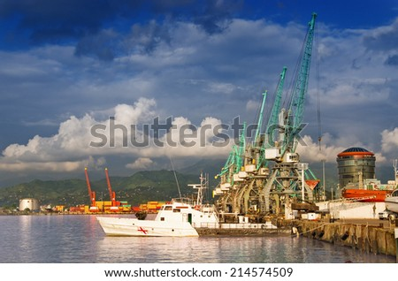Cranes at the container port terminal dawn  time in Batumi - stock photo