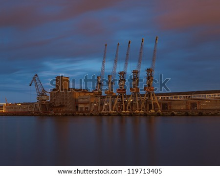 Cranes in harbour at night. Gdansk, Poland.