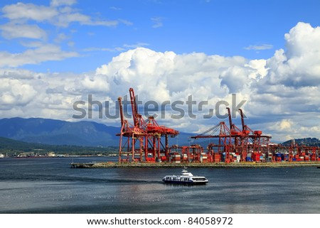 Cranes in port of Vancouver city and container terminal (Canada)