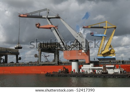 cranes in Rotterdam harbor - stock photo