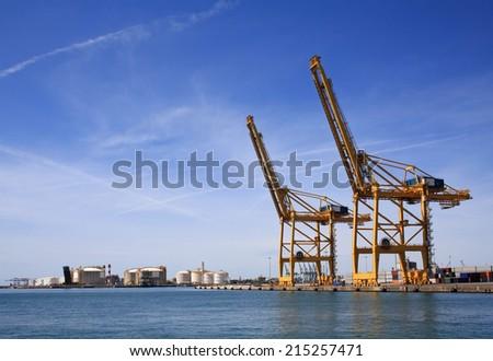 Cranes in the Barcelona port - stock photo